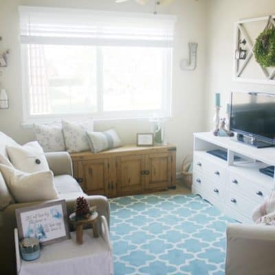 pros and cons of small home living living room with aqua rug sofa console tv window and bench