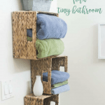 affordable storage solutions small bathrooms three wicker baskets with towels and decor items mounted to wall and various photos of storage solutions