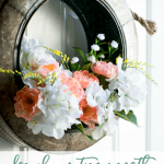 spring tire wreath on door with peach and white flowers