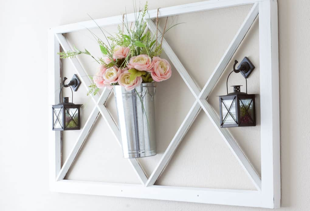 spring home tour decor ideas curating a home vintage window pane with metal bucket and flowers with black lanterns hanging on the wall