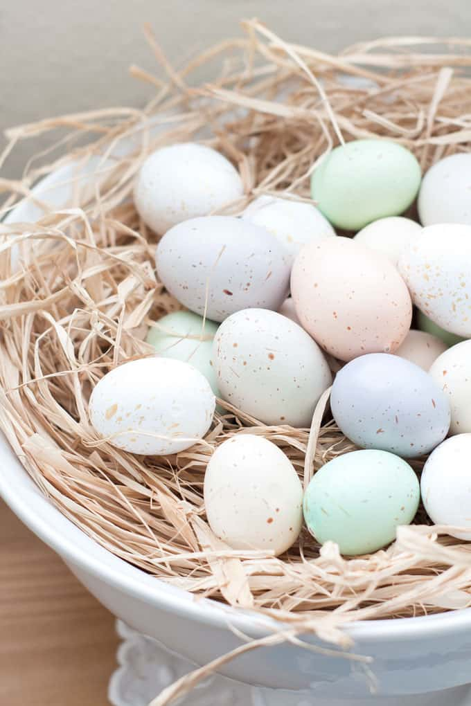 spring home tour decor ideas curating a home pastel eggs with rafia in white bowl