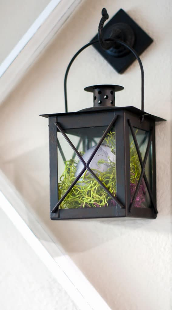spring home tour decor ideas curating a home vintage window pane with black lanterns with egg and moss inside hanging on the wall