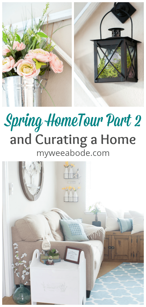 spring home tour part 2 curating a home pink yellow flowers in metal vase black lantern with egg view of living room with love seat and spring decor