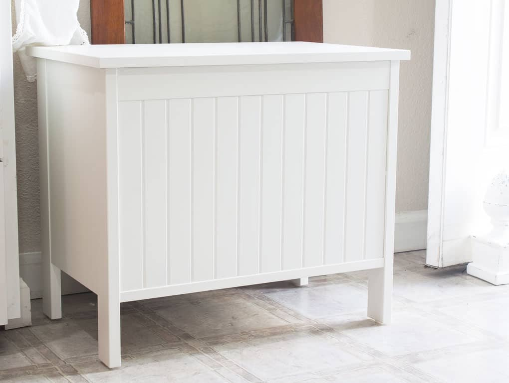 Closeup of an IKEA Silveran white storage bench