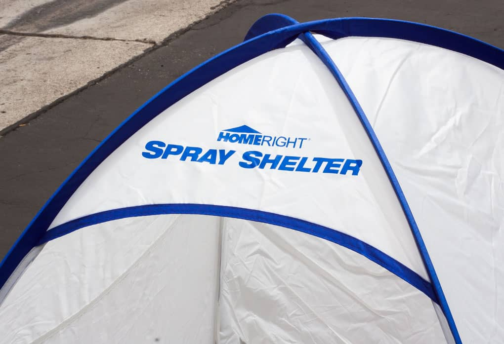 top of spray shelter with title homeright spray shelter in blue