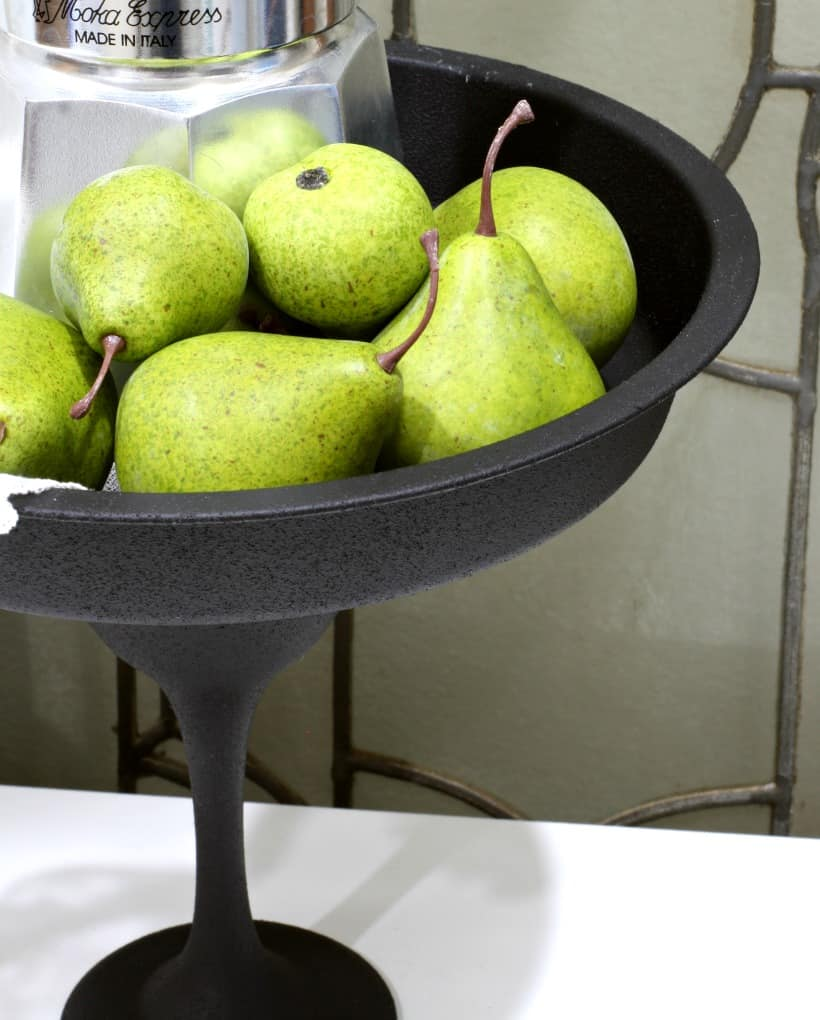 black cake plate with pears