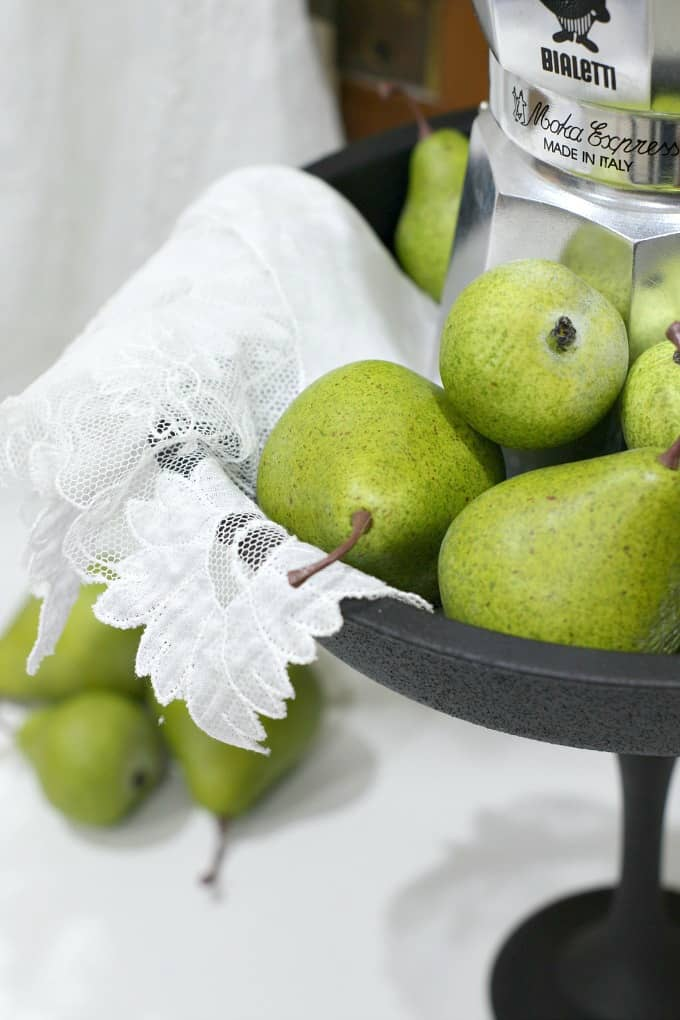 pears in cake plate with linen fabric with pears in the background