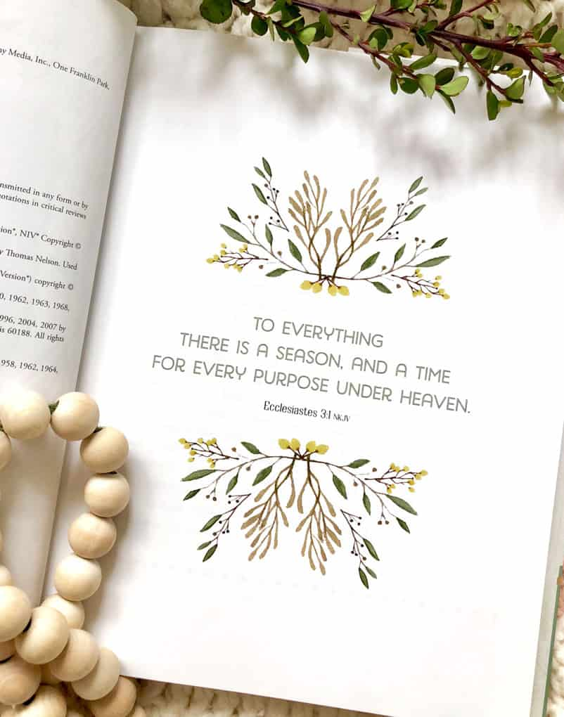 Bible verse and line drawings inside of book with wooden beads