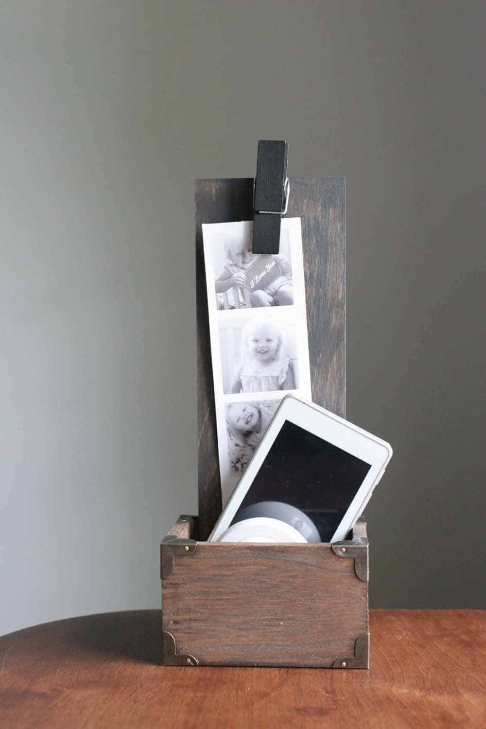 wooden box phone holder with photo attached with clothespin and cell phone