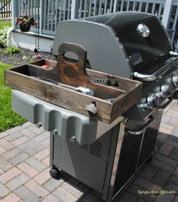 bbq grill with wooden tool caddy in backyard