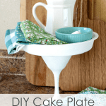 white cake plate with pitcher bowl linens titled DIY cake plate
