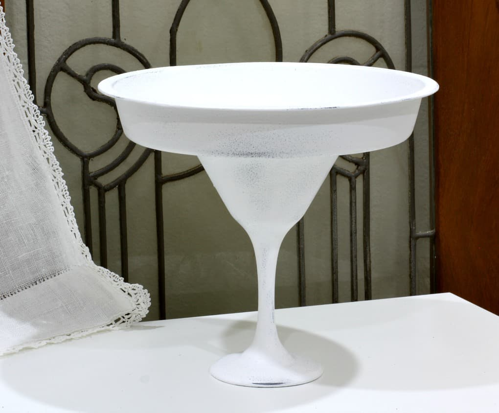 white pedestal bowl with leaded glass in background