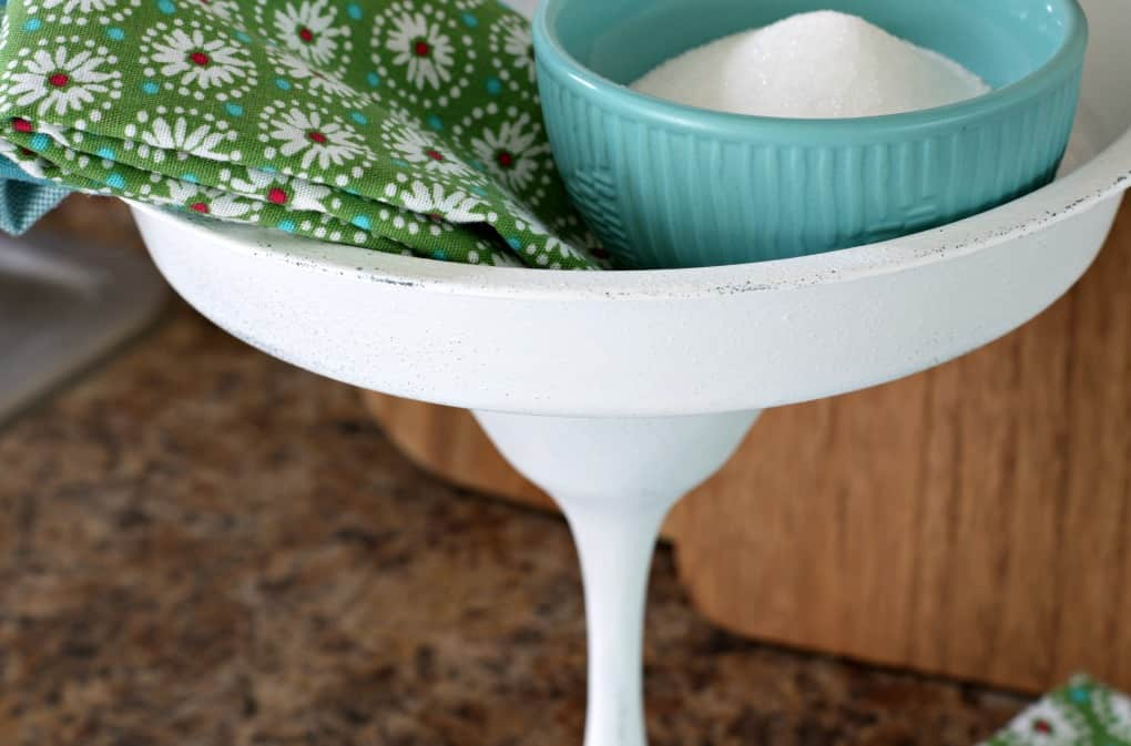 closeup of white cake plate with aqua bowl and printed napkin