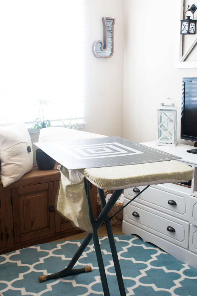 easy sew or new-sew pleated bed skirt ironing board with cutting mat in living room with bench and media console