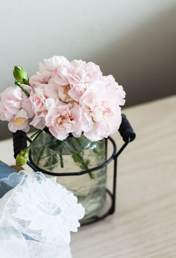 pink carnations in vase with linen