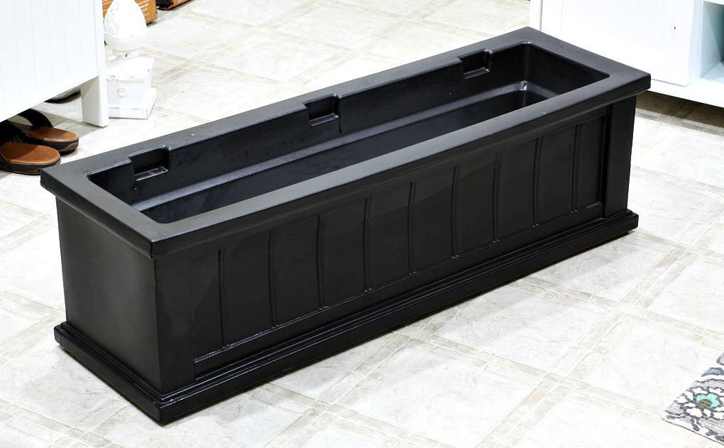 black window box sitting in vinyl floor