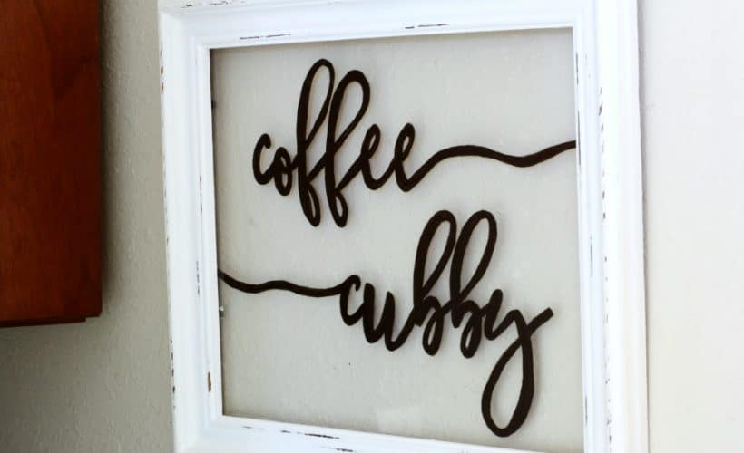 frame and glass on wall with coffee cubby painted on glass