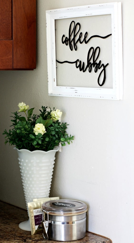coffee cubby framed sign on wall with flower vase sitting on counter