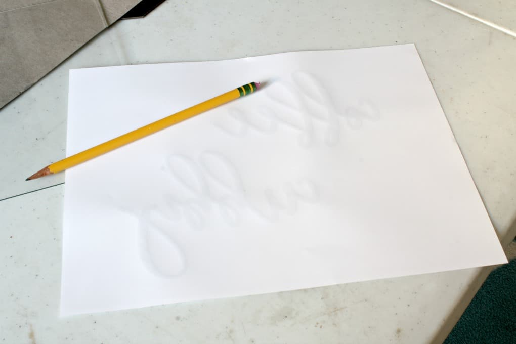 paper sitting on table with pencil