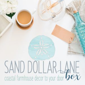 white counter with coffee aqua sand dollar bottle tag twine and frame with white flower