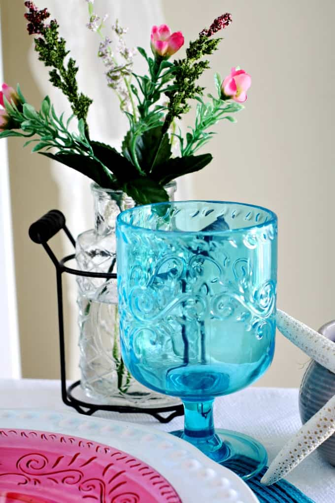 aqua goblet with flower vase and starfish