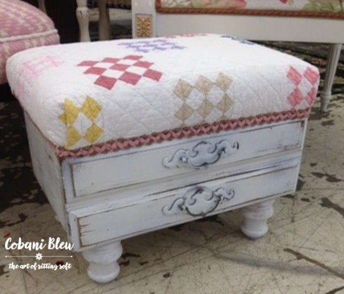 ottoman with white wooden drawer base and pulls with country fabric cushion top