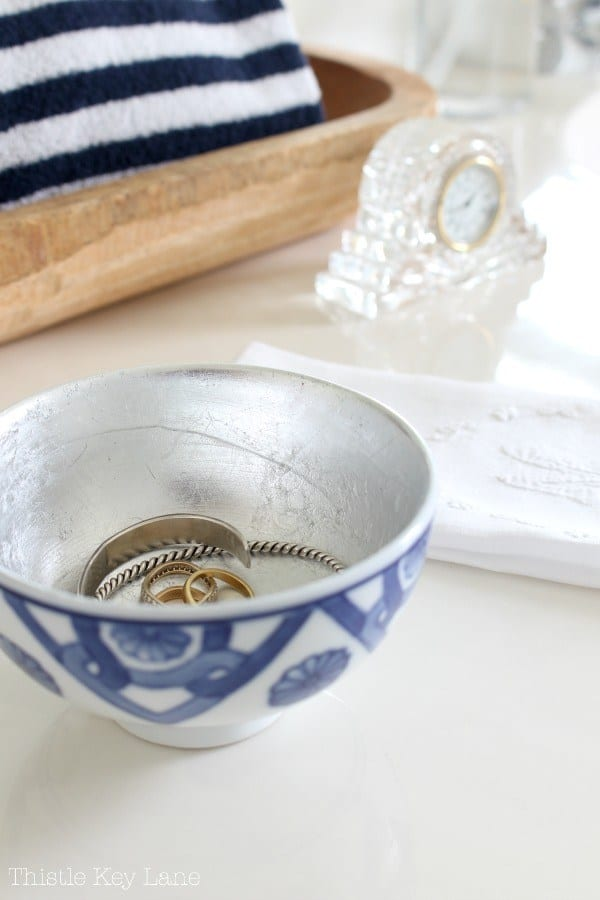 tuesday turn about #5 the best blog posts on the web blue and white bowl with silver gilding leafing on the inside holding jewelry on a table top