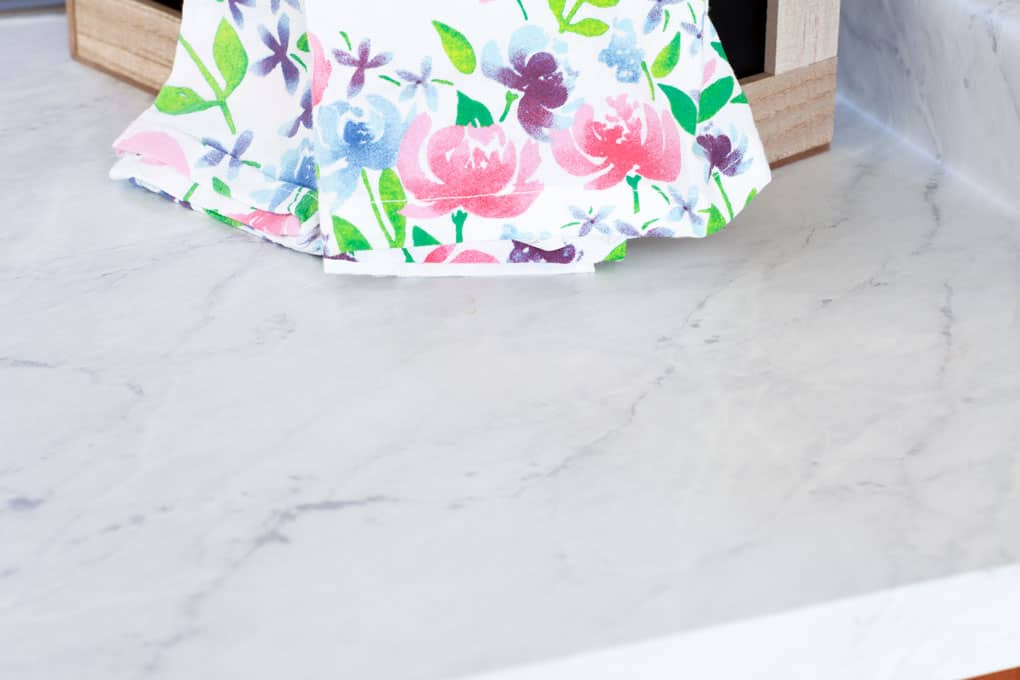 update your countertops without replacing them wooden crate with tea towels dish liquid and plant on marble countertop