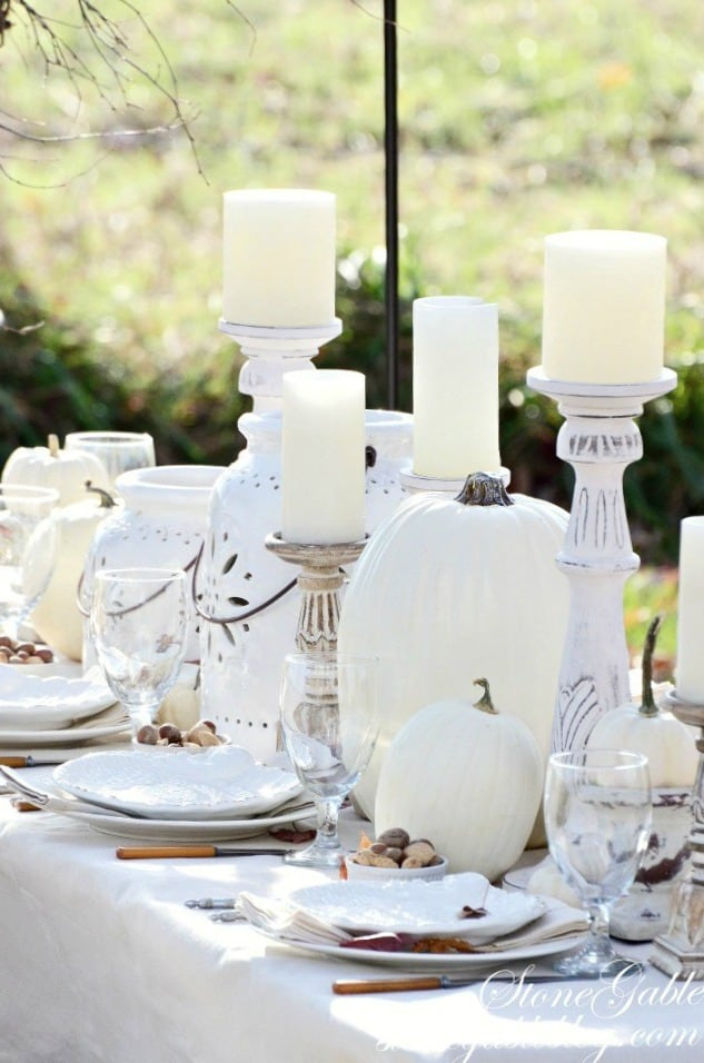 tuesday turn about #6 tablescape with white dishes glasses candle holders lanterns and pumpkins