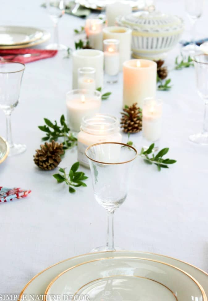 tuesday turn about #6 tablescape with white dishes glasses candle holders and pine cones
