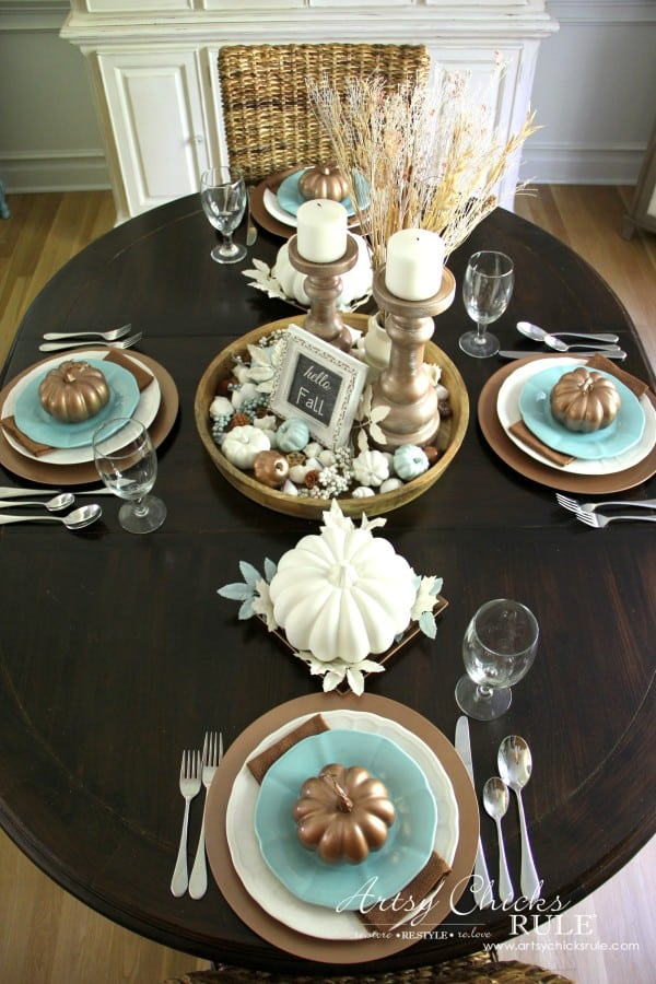 Tuesday turn about #7 tablescape in aquas copper and whites with plates and glassware featuring pumpkins