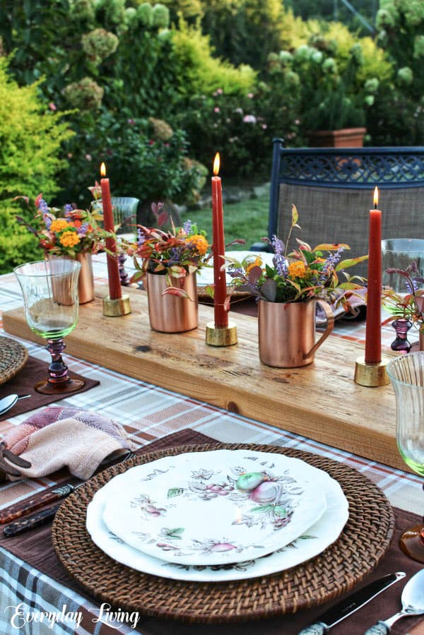 Tuesday turn about #7 outdoor tablescape with copper watering cans candles dishes and glasses