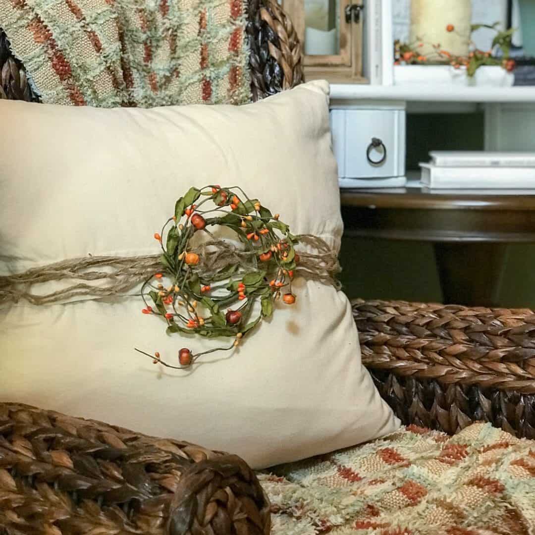 Tuesday turn about #7 linen pillow on chair with twine and candle ring tied around pillow