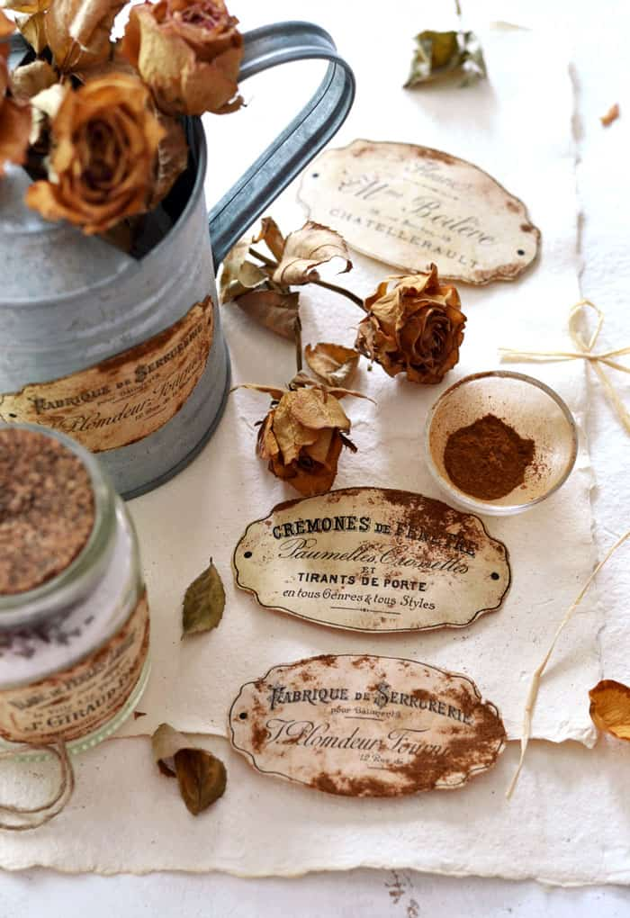 Tuesday turn about #7 vintage labels on galvanized pitcher with cinnamon and roses