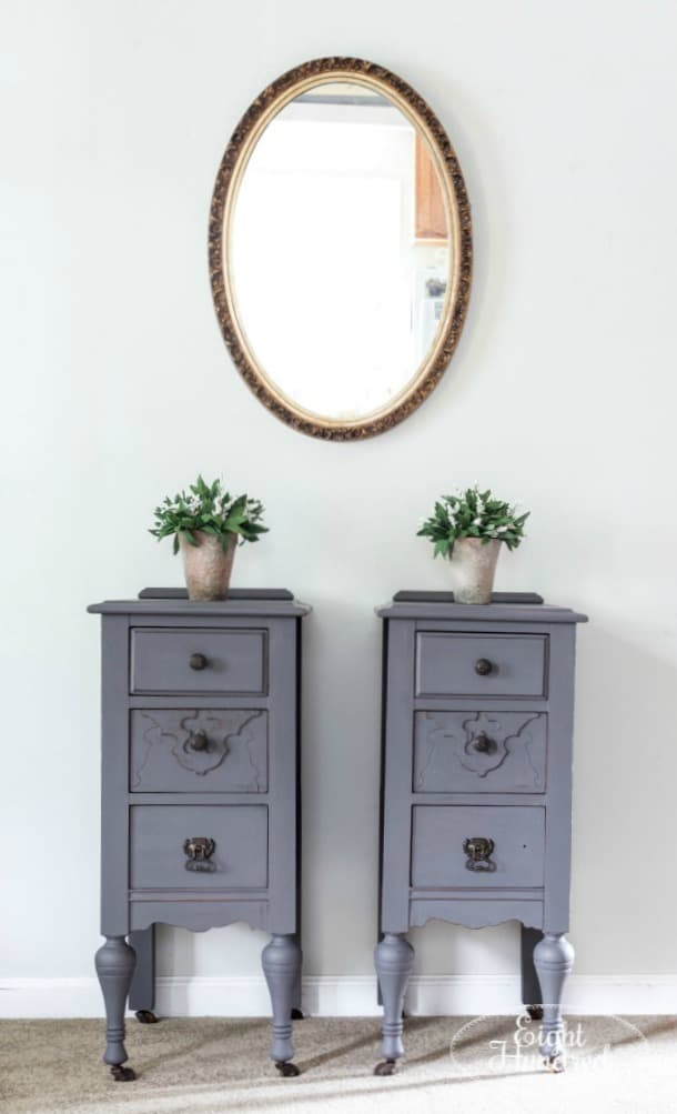 tuesday turn about #6 gray night stands with plants sitting on top and oval mirror hanging above
