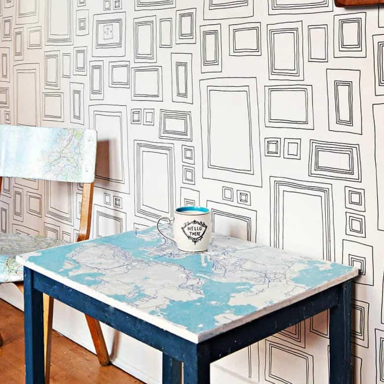 tuesday turn about #6 chair and table with map covered table top next to wall with modern wall paper