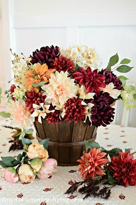 tuesday turn about #6 fall flower arrangement in wooden bucket pail