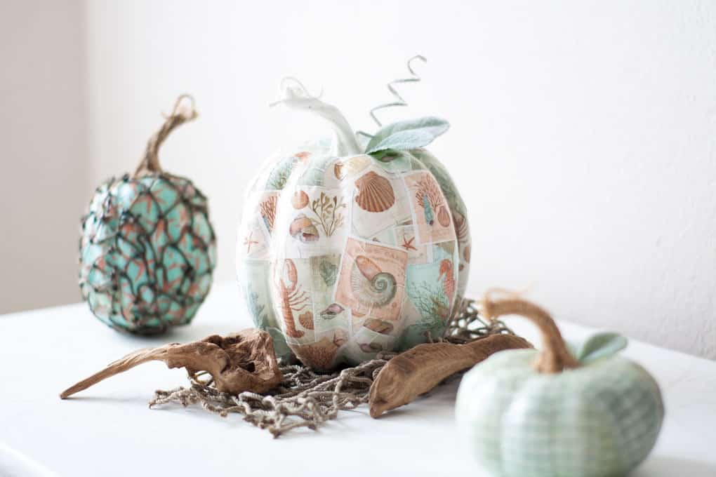 diy mod podge pumpkins coastal style pumpkins with coastal pattern and leaves and stem on white table