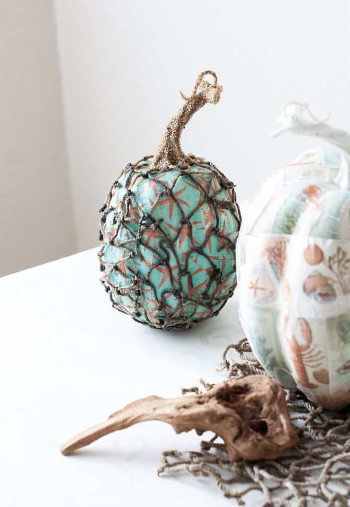 diy mod podge pumpkins coastal style pumpkin with starfish pattern and fishnet cover on white counter