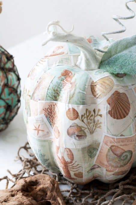 diy mod podge pumpkins coastal style pumpkin with coastal pattern and leaves and stem on white table