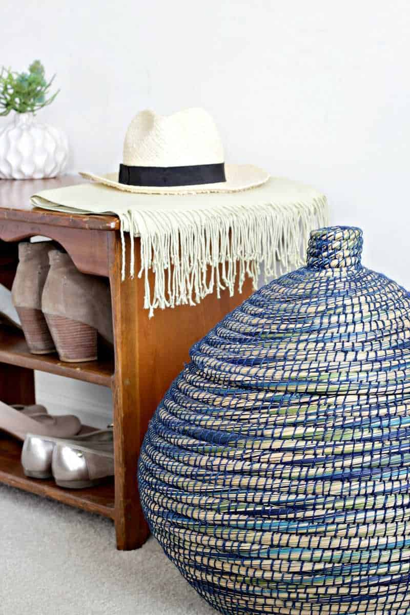 tuesday turn about 8 shoe shelf with straw hat and blue and white basket with lid in room necklace hanger on wall