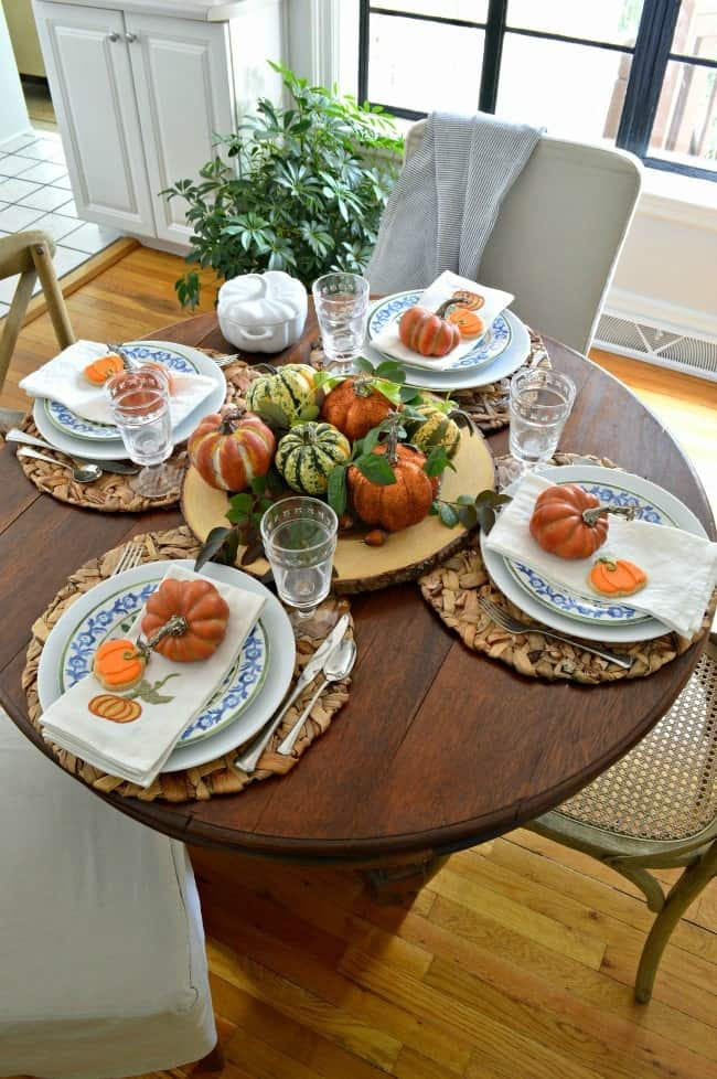 tuesday turn about 9 best blog diys tablescape with pumpkins and plates in blue and white with fall elements