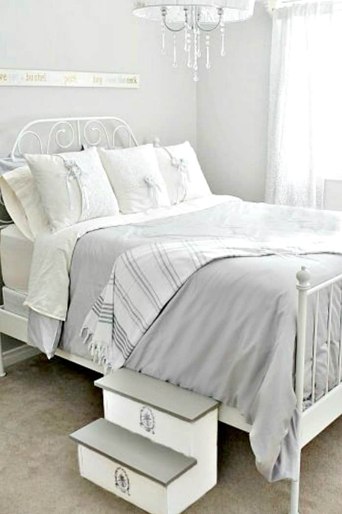 tuesday turn about 9 best blog diys bed with white gray linens and step stool in bedroom