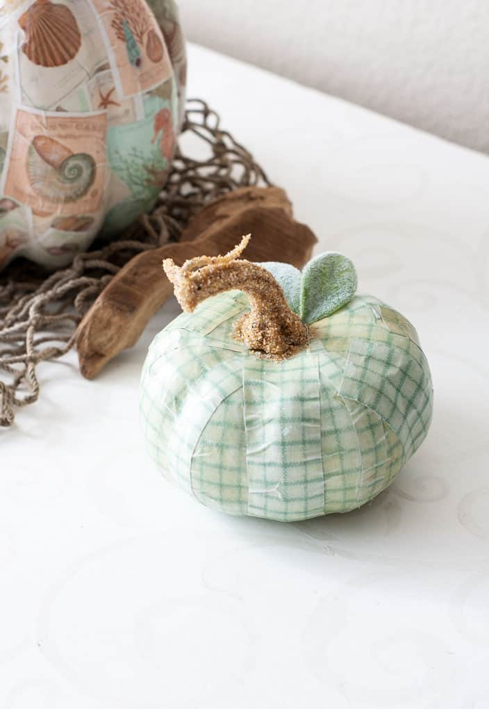 tuesday turn about 9 best blog diys plaid green pumpkin with sand covered stem and Lamb's Ear leaves on white counter