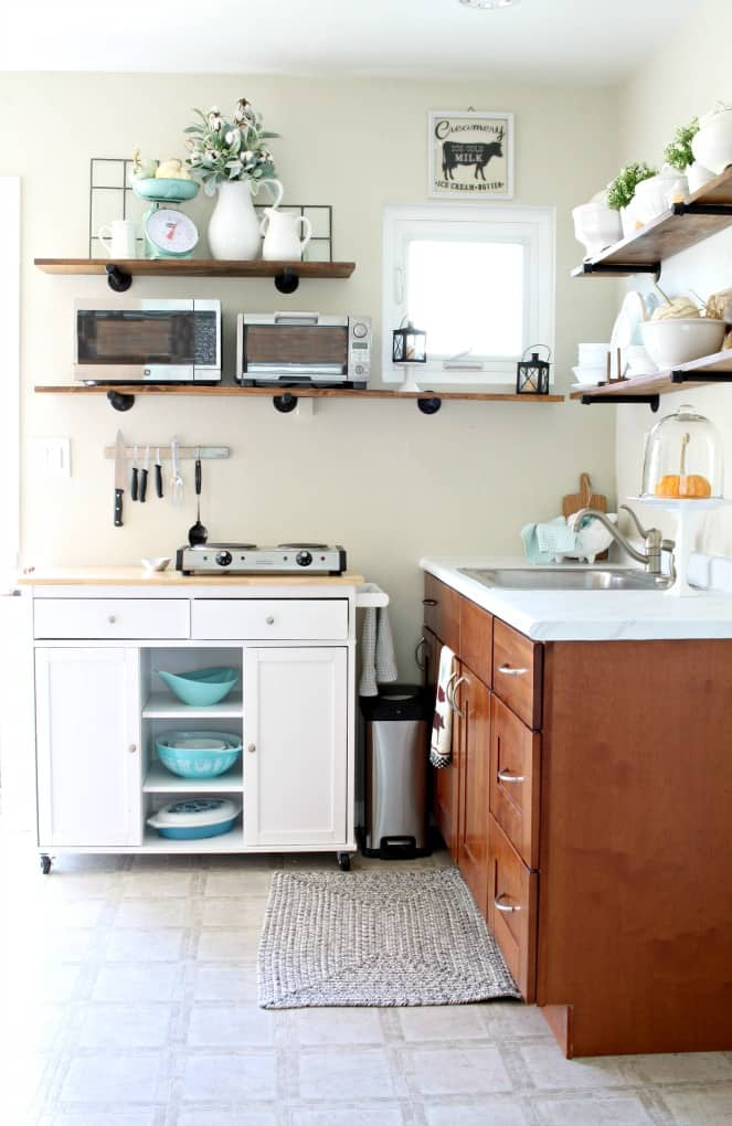adding fall decor to a small kitchen small kitchen with cupboards open shelving portable island and decor items