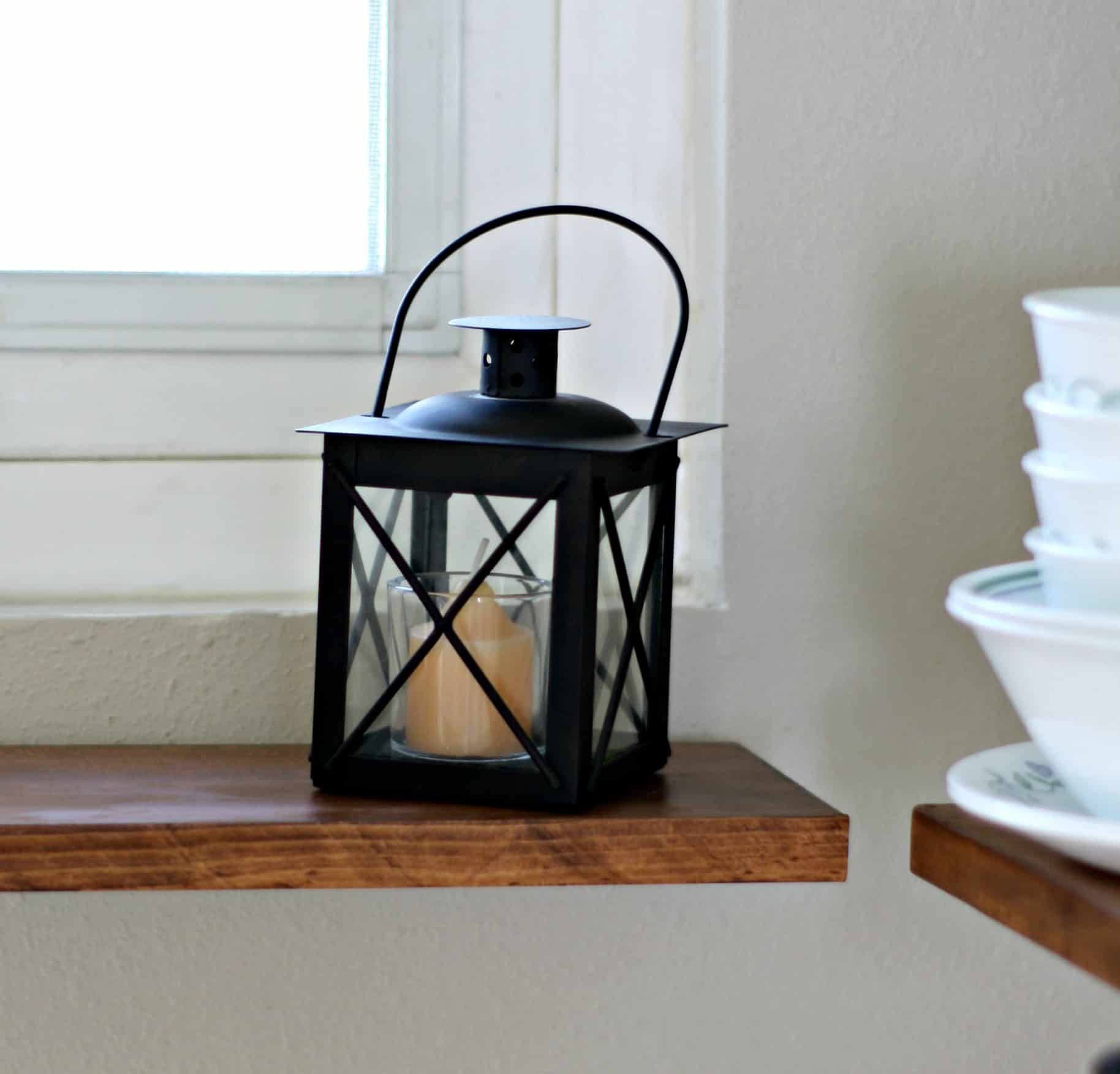 adding fall decor to a small kitchen black lantern on wood surface