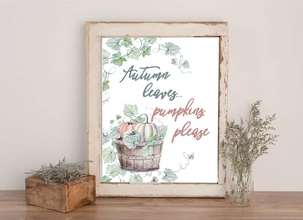 free watercolor fall printables photo of bushel of pumpkins nested in vines and leaves sitting on table with lavender accents
