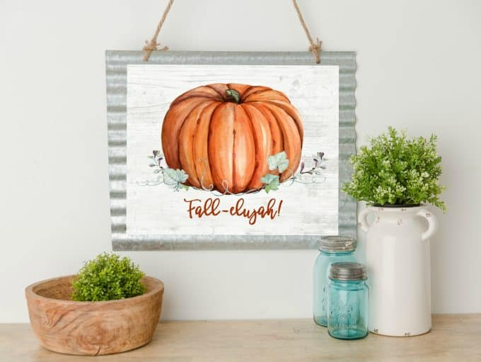 free watercolor fall printables watercolor of pumpkin vines and leaves on shiplap background with plants and mason jars
