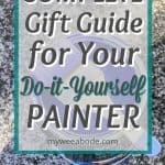 9 Painting Tools to Update Your Apartment with a Designer Look paint can and brush in background with title ultimate gift guide for your do it yourself painter