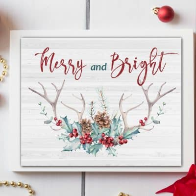 free watercolor printables christmas winter photo with antlers and berries and greenery with the words merry and bright